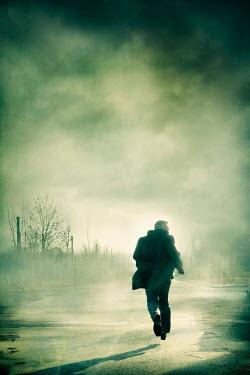 Silas Manhood MAN RUNNING IN FOGGY STREET Men