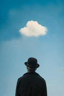 Terry Bidgood Man in bowler hat standing under cloud