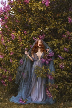 Beata Banach Young woman in blue dress under wisteria tree