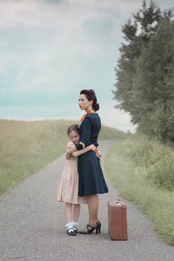 Joanna Czogala Woman and her daughter standing on rural road
