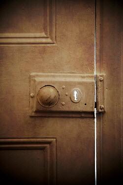 Miguel Sobreira Light Through Keyhole in Door