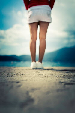 Paolo Martinez Legs of young woman standing by lake