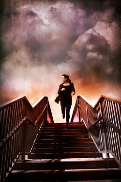 Silas Manhood WOMAN RUNNING DOWN STEPS WITH STORMY SKY Women