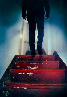 Silas Manhood MAN WALKING ON SHABBY STAIRCASE INDOORS Men