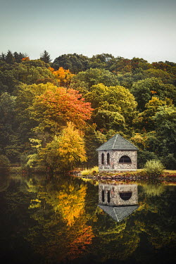 Evelina Kremsdorf Autumn forest, river, and stone hut in Tarrytown, New York, USA