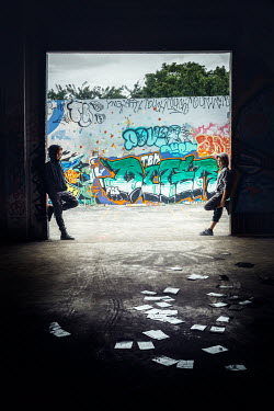 Evelina Kremsdorf Teenage boys standing in tunnel by graffiti wall