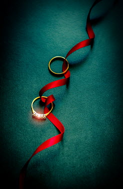 Jane Morley Wedding rings on red ribbon