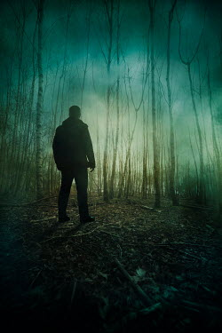 Silas Manhood MAN STANDING IN FOGGY FOREST IN WINTER Men
