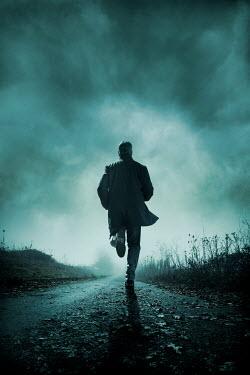 Silas Manhood MAN RUNNING ON COUNTRY ROAD IN WINTER Men