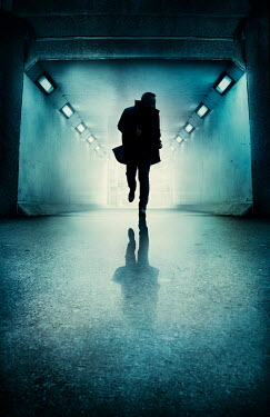 Silas Manhood SILHOUETTED MAN RUNNING FROM UNDERPASS AT NIGHT Men