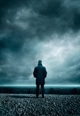Silas Manhood MAN IN COAT WATCHING SEA WITH STORMY SKY Men