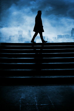 Silas Manhood SILHOUETTED MAN WALKING BY STEPS IN CITY AT NIGHT Men