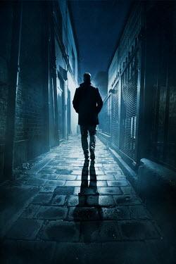 Silas Manhood MAN WALKING IN URBAN ALLEYWAY AT NIGHT Men