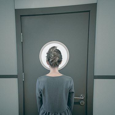 Dasha Pears GIRL LOOKING AT ROUND WINDOW IN DOOR Women