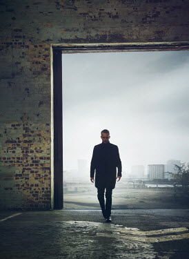 Mark Owen MAN WALKING IN OPEN FACTORY BUILDING Men