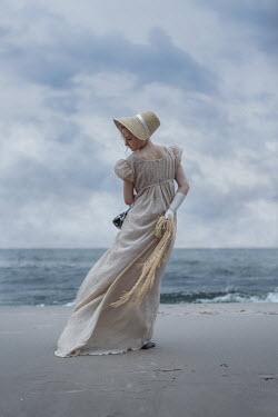Magdalena Russocka REGENCY WOMAN STANDING ON WINDY BEACH Women
