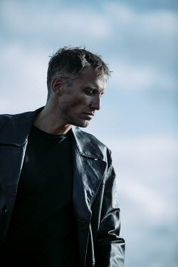 Magdalena Russocka close up of modern man wearing leather jacket outside