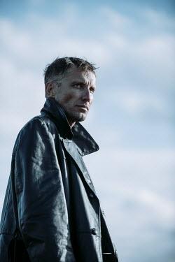 Magdalena Russocka close up of modern man wearing leather jacket outside