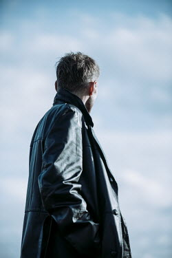 Magdalena Russocka MAN IN LEATHER JACKET STANDING OUTDOORS Men