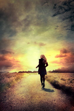 Silas Manhood BLONDE WOMAN RUNNING IN COUNTRYSIDE AT SUNSET Women