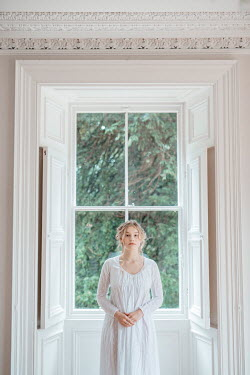 Shelley Richmond BLONDE REGENCY WOMAN STANDING INDOORS BY WINDOW Women