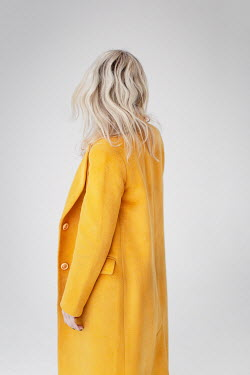Dasha Pears BLONDE WOMAN STANDING IN YELLOW COAT Women