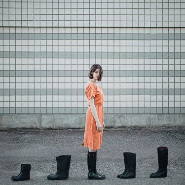 Dasha Pears WOMAN STANDING OUTDOORS WITH BOOTS Women