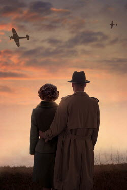 Lee Avison 1940s couple watching fighter planes at sunset during world war two