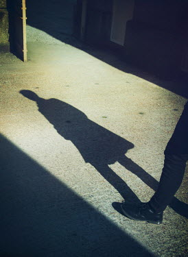 Mark Owen SHADOW OF MAN ON CONCRETE FLOOR OF BUILDING Men