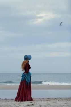 Magdalena Russocka victorian woman standing on beach Women