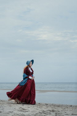 Magdalena Russocka victorian woman in bonnet on beach Women