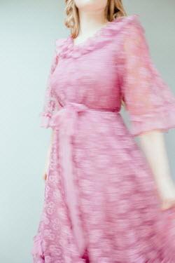 Shelley Richmond BLONDE WOMAN IN PINK LACE DRESS Women