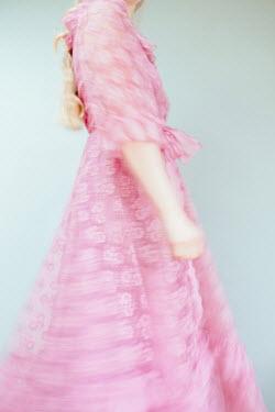 Shelley Richmond BLURRED BLONDE WOMAN IN PINK LACE DRESS Women