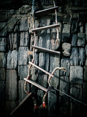 David Baker Broken ladder and stone wall