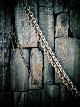 David Baker Rusted chain and stone wall
