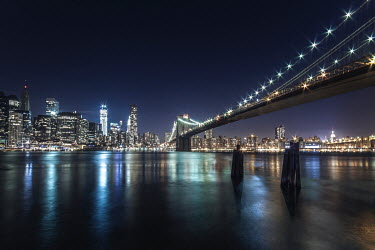Evelina Kremsdorf Brooklyn Bridge at night in New York City, USA