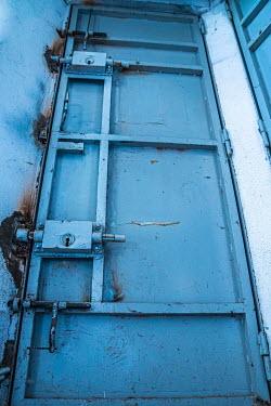 Elly De Vries Blue prison door
