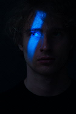 Magdalena Russocka man's face in shadow with blue light