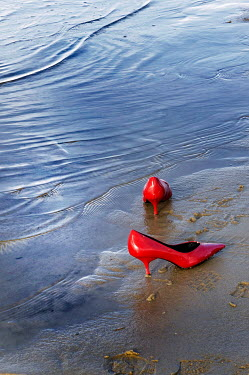 Ute Klaphake Red high heels on beach