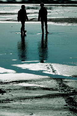 Ute Klaphake Silhouette of boys walking on beach