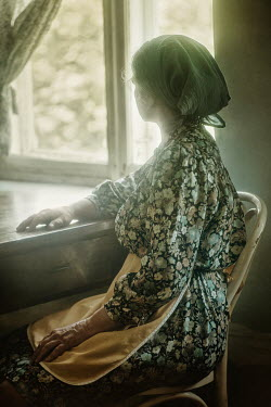 Natasza Fiedotjew OLD WOMAN IN HEADSCARF SITTING BY WINDOW Old People