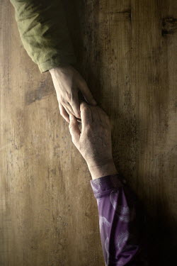 Natasza Fiedotjew Young and old hand holding each other