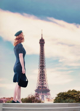 Elisabeth Ansley 1950s young woman by the Eiffel Tower, Paris, France