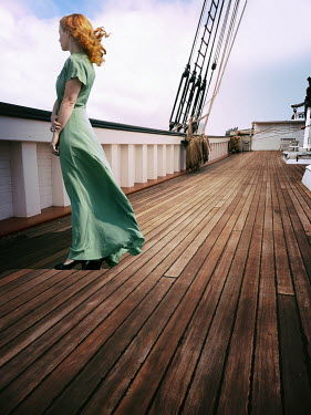 Elisabeth Ansley Young woman in green dress standing on deck of boat