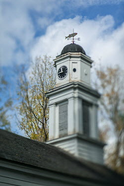 Lisa Bonowicz Clock on church under clouds