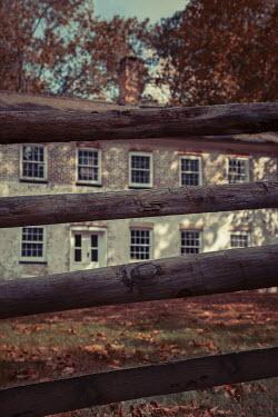 Lisa Bonowicz Wooden fence and brick house