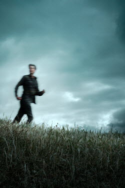 Miguel Sobreira Blurred man running on hill