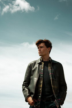 Miguel Sobreira Young man in leather jacket against clouds