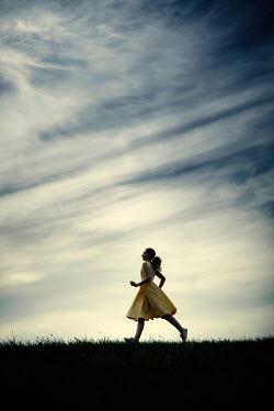 Magdalena Russocka girl running in field