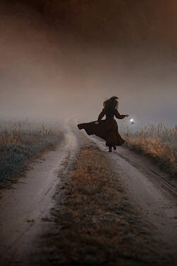 Natasza Fiedotjew Historical woman running with lantern at night in fog